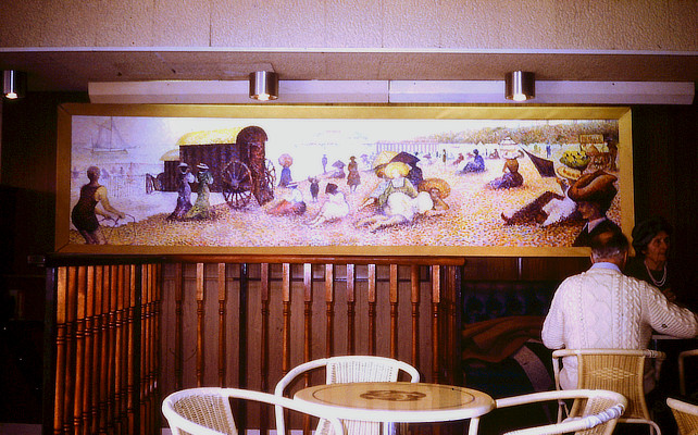 painting of panoramic Victorian seaside resort scene in Pointillist style on a cafe wall