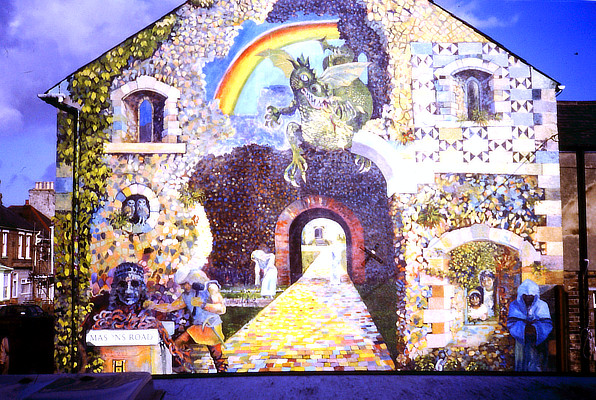 fantastical wall mural on gable end of terraced houses featuring a rainbow and a dragon