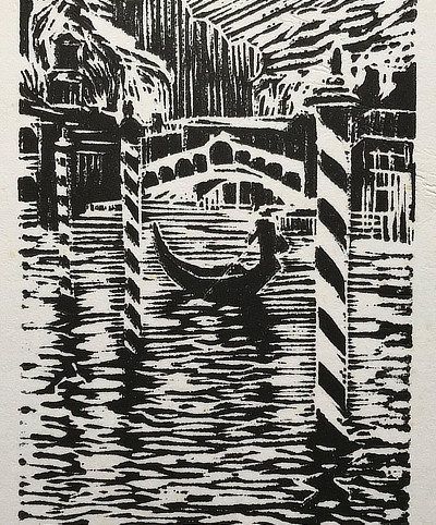 linocut of a Venice gondola on a waterway with bridge behind